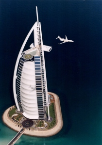 Flying high in Dubai: The Global Express business jet flies past the iconic Burj Al Arab Hotel. Bombardier photo
